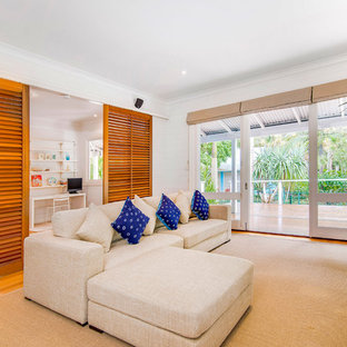 This is an example of a beach style family room in Gold Coast - Tweed.