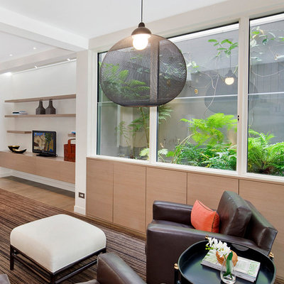 Inspiration for a contemporary open concept family room remodel in Sydney with white walls