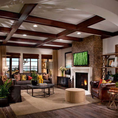 Inspiration for a mediterranean enclosed family room remodel in San Francisco with a standard fireplace