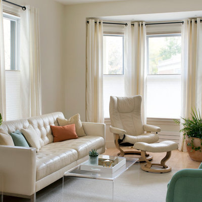 Family room - mid-sized transitional enclosed light wood floor and beige floor family room idea in Boston with beige walls, no fireplace and a wall-mounted tv
