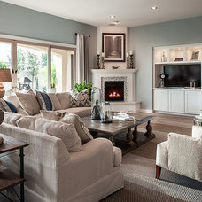 Transitional Family Room by Camelot Homes