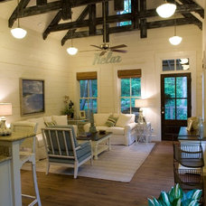Rustic Family Room by Pine Mountain Builders, LLC