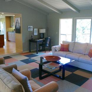 サンフランシスコのコンテンポラリースタイルのおしゃれなオープンリビング (カーペット敷き、標準型暖炉、レンガの暖炉まわり、マルチカラーの床) の写真