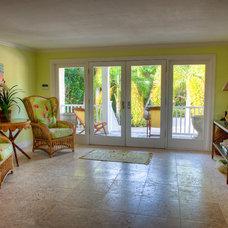 Tropical Family Room by GH3 Enterprises LLC