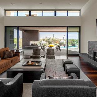 Inspiration pour une grande salle de séjour minimaliste ouverte avec un mur blanc, un sol en bois foncé, une cheminée ribbon, un manteau de cheminée en carrelage, un téléviseur fixé au mur et un sol marron.