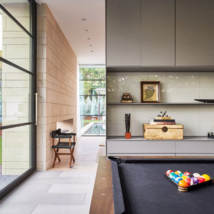 Example of a large trendy open concept porcelain floor game room design in Dallas with no fireplace and no tv