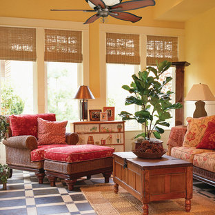 Design ideas for a tropical family room in Miami with beige walls.