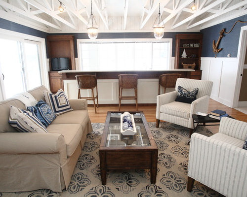 Example Of A Classic Medium Tone Wood Floor Family Room Design In Tampa  With Blue Walls