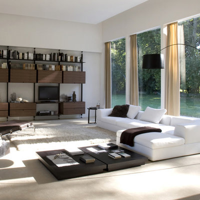 Family room - large modern family room idea in Philadelphia with white walls and no fireplace