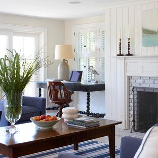 ボストンの大きいビーチスタイルのおしゃれなファミリールーム (ベージュの壁、磁器タイルの床、標準型暖炉、レンガの暖炉まわり、テレビなし、白い床) の写真