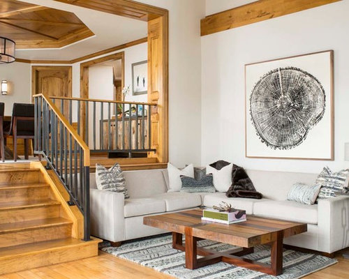 Huge Mountain Style Medium Tone Wood Floor Family Room Photo In Denver With  White Walls And