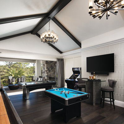 Game room - traditional dark wood floor and brown floor game room idea in Miami with beige walls and a wall-mounted tv