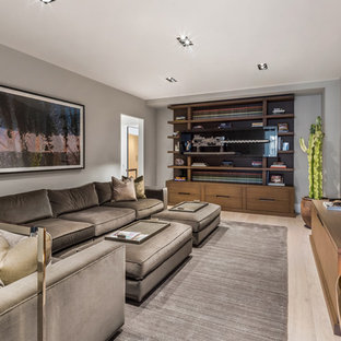 Inspiration for a mid-sized contemporary enclosed light wood floor and beige floor family room remodel in New York with no fireplace, a wall-mounted tv and gray walls
