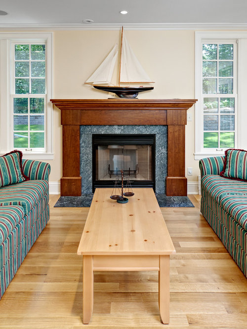 traditional light wood floor family room idea in minneapolis with beige walls a standard fireplace