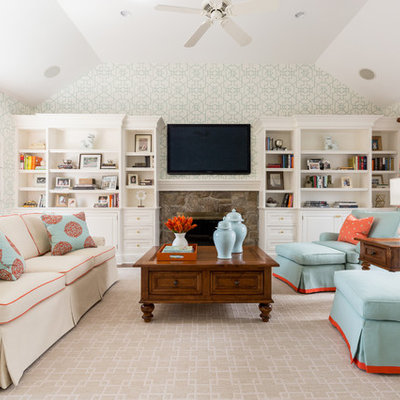 Family room - traditional family room idea in New Orleans with a standard fireplace and a stone fireplace