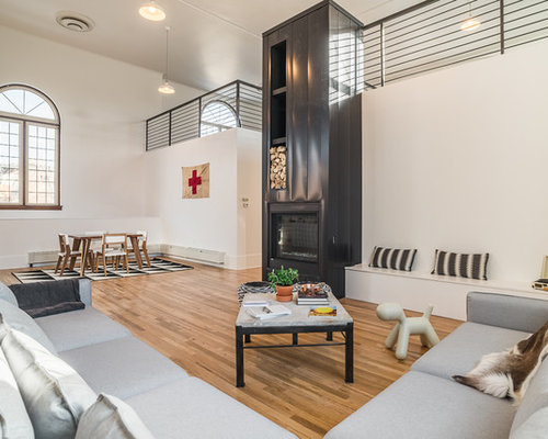 Inspiration For An Industrial Open Concept Medium Tone Wood Floor Family  Room Remodel In Denver With
