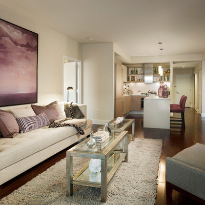 Example of a small trendy open concept dark wood floor family room design in New York with beige walls, no fireplace and a tv stand