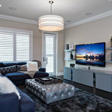Transitional Family Room by Gervis Design Studio