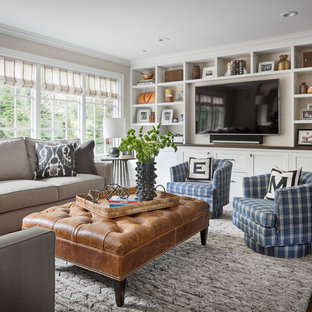 Example of a transitional dark wood floor and brown floor family room design in New York with beige walls and a media wall