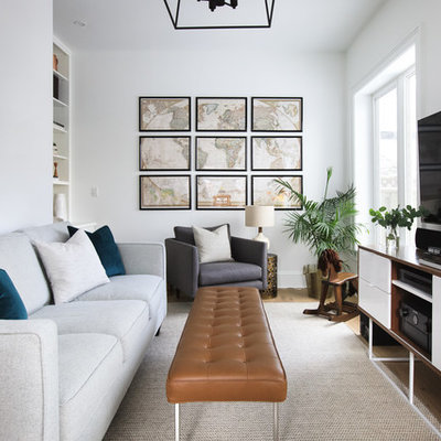 Small transitional open concept light wood floor and brown floor family room photo in Toronto with white walls, no fireplace and a wall-mounted tv