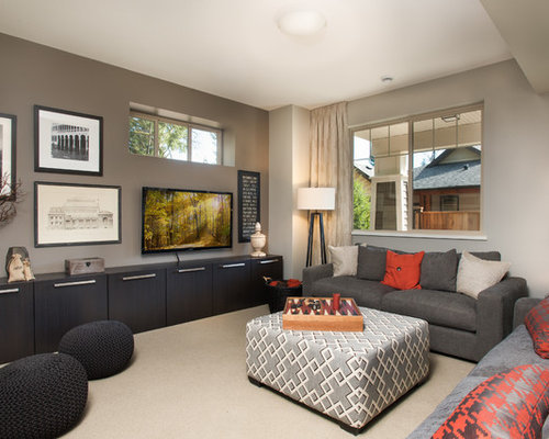 Trendy Carpeted Family Room Photo In Vancouver With Gray Walls And A  Wall Mounted Tv