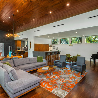 Example of a mid-sized 1950s open concept medium tone wood floor and brown floor family room design in Dallas with white walls and a music area