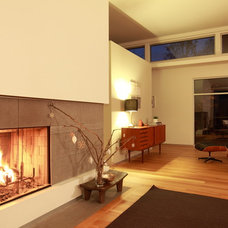 Contemporary Family Room by Faust Construction
