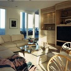 Tropical Family Room by Adesso Interior Design