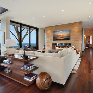 Large trendy open concept family room photo in Orange County with a two-sided fireplace and white walls