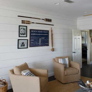 Inspiration for a small coastal enclosed dark wood floor and brown floor family room remodel in Jacksonville with white walls