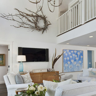 Inspiration for a tropical open concept dark wood floor family room remodel in Miami with white walls and a wall-mounted tv