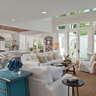Cottage chic open concept dark wood floor family room photo in Miami with white walls and a wall-mounted tv