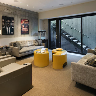 Trendy carpeted and gray floor family room photo in Los Angeles with gray walls