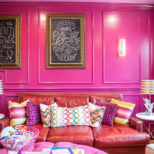 Large transitional enclosed game room photo in Austin with pink walls and a wall-mounted tv