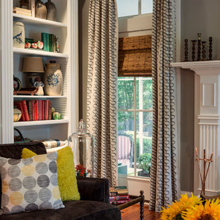 Family room - large transitional enclosed medium tone wood floor family room idea in Atlanta with gray walls, a standard fireplace, a wood fireplace surround and a media wall