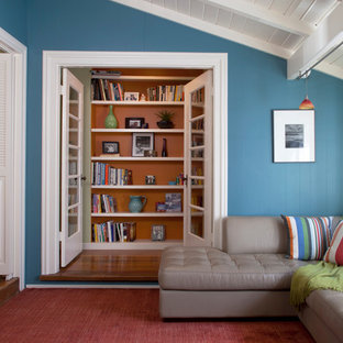 Inspiration for a mid-sized coastal enclosed medium tone wood floor family room library remodel in San Francisco with blue walls