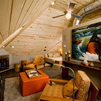 Example of a trendy family room design in Denver with beige walls and a standard fireplace