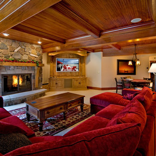 Large mountain style open concept carpeted family room photo in Chicago with a standard fireplace, a stone fireplace and a media wall