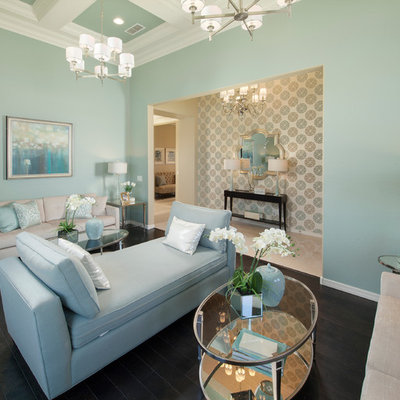 Elegant family room photo in Phoenix with blue walls and no tv