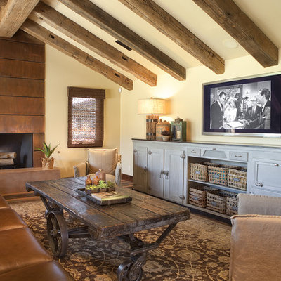 Example of a mid-sized classic enclosed dark wood floor and brown floor family room design in Phoenix with a metal fireplace, a standard fireplace, beige walls and a wall-mounted tv