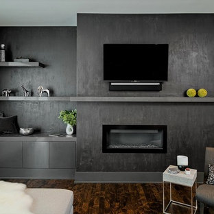 Inspiration for a mid-sized contemporary open concept dark wood floor and brown floor family room remodel in Minneapolis with a ribbon fireplace, a wall-mounted tv and gray walls