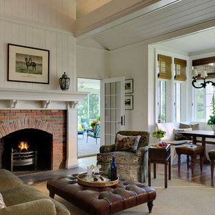 Elegant open concept family room photo in New York with white walls, a standard fireplace and a brick fireplace