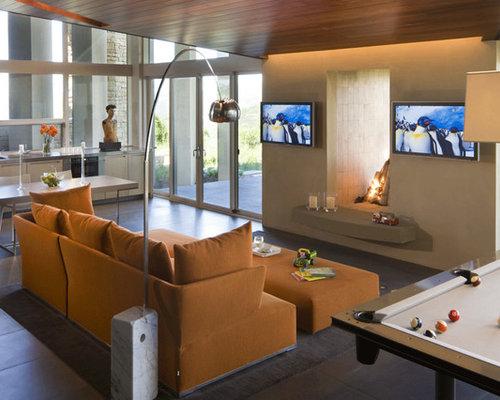 diseo de sala de juegos en casa abierta con paredes beige chimenea