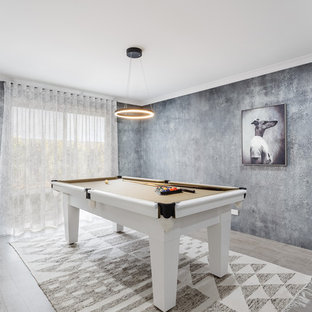 Mid-sized contemporary open concept family room in Perth with a game room, grey walls, ceramic floors and grey floor.