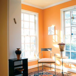 Inspiration for a contemporary medium tone wood floor family room remodel in DC Metro with orange walls