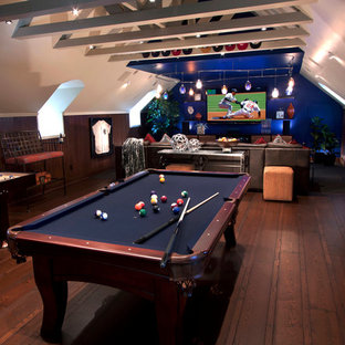 This is an example of a contemporary family and games room in Other with blue walls, a game room and brown floors.