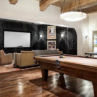 Exemple d'une salle de séjour tendance avec salle de jeu et un sol marron.