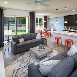 Trendy open concept family room photo in Orlando with a wall-mounted tv