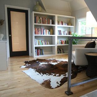 Trendy loft-style light wood floor family room photo in Boston
