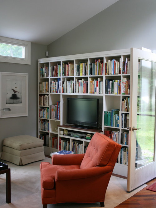 Example Of A Trendy Medium Tone Wood Floor Family Room Design In Burlington With Library